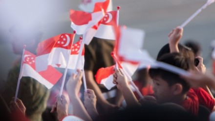 Crowd with Singaporean flags