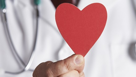 Doctor holding a paper heart