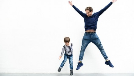 Man and child jumping around healthily