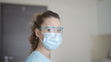 Photo of hospital worker wearing protective eye wear and face mask, COVID19